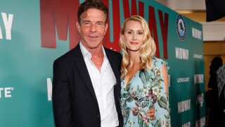 """Dennis Quaid and fiancee Laura Savoie arrive at the """"Midway"""" Special Screening at Joint Base Pearl Harbor-Hickam on October 20, 2019 in Honolulu, Hawaii. (Photo by Marco Garcia/Getty Images for Lionsgate Entertainment)"""