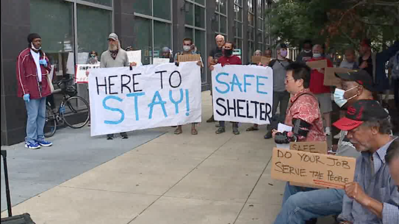 Homeless men living at Ramada Inn gather outside county headquarters