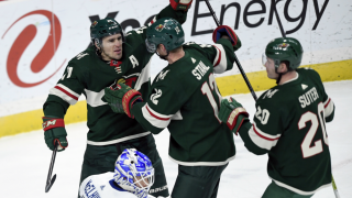 Zach Parise congratulated