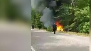 Video shows officers pull man from burning car