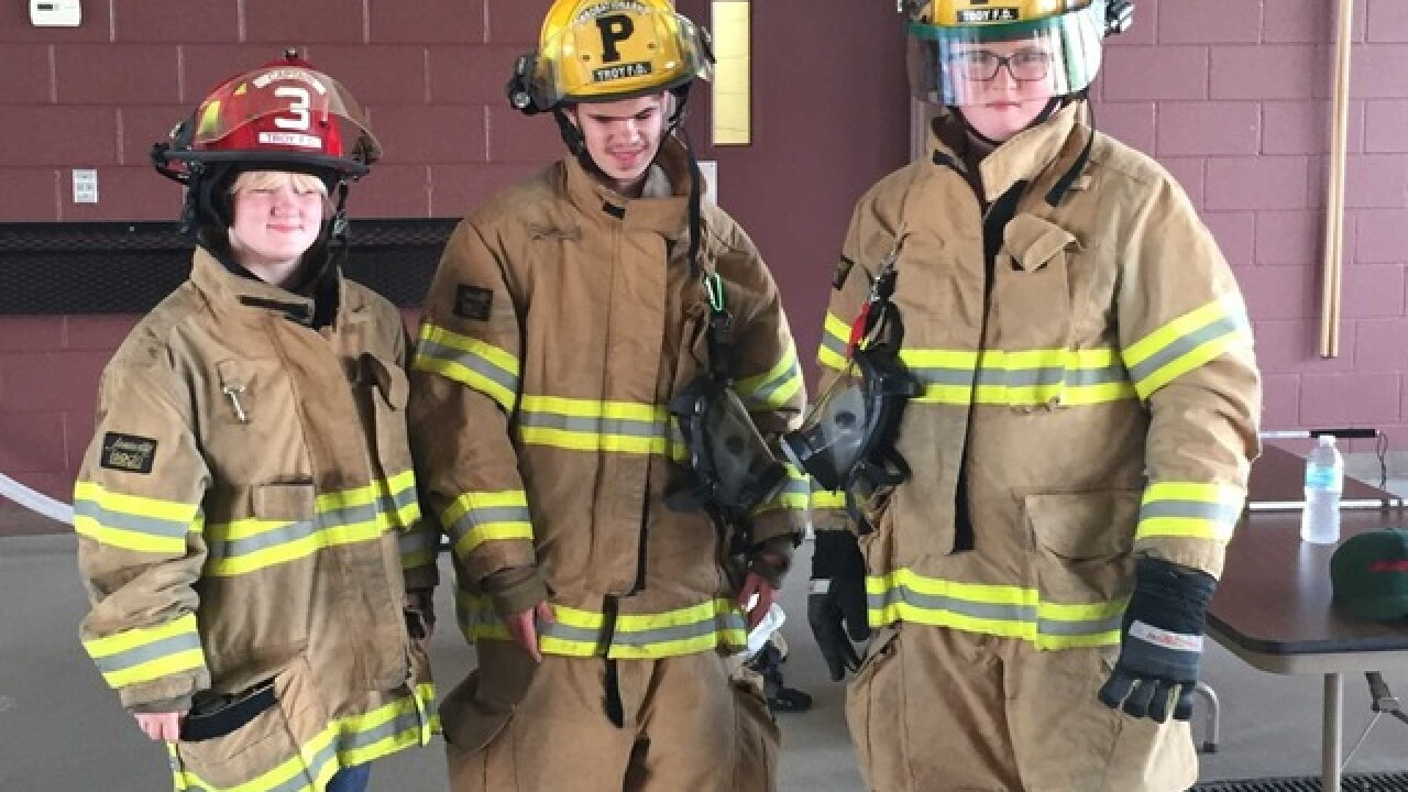 Blind campers get taste of life at fire dept.