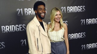 Sienna Miller says Chadwick Boseman gave up part of salary so she could be paid more on '21 Bridges'