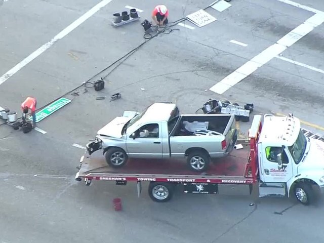 PHOTOS: Driver slams into, takes out concrete pole in West Palm Beach