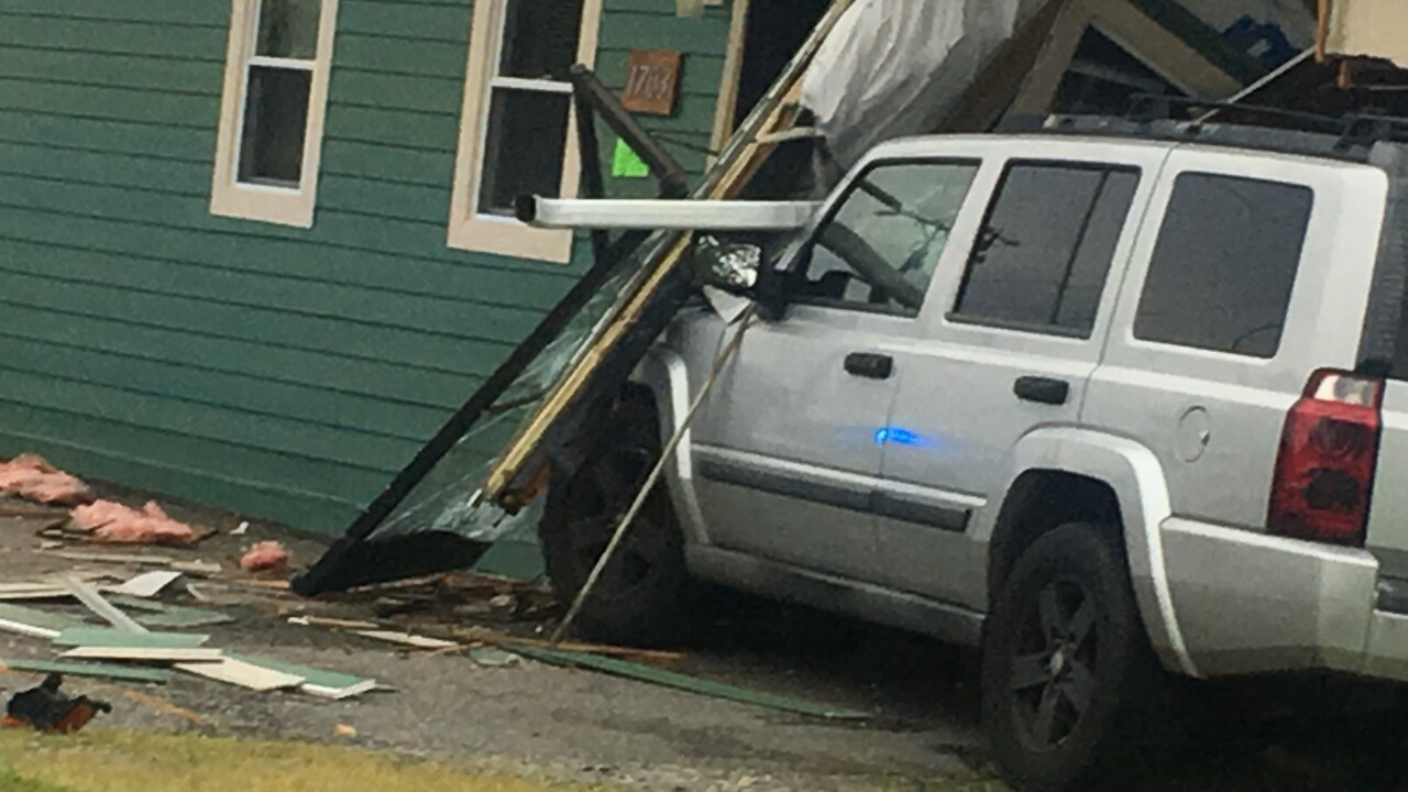 Vehicle crashes into Newport News building during police chase