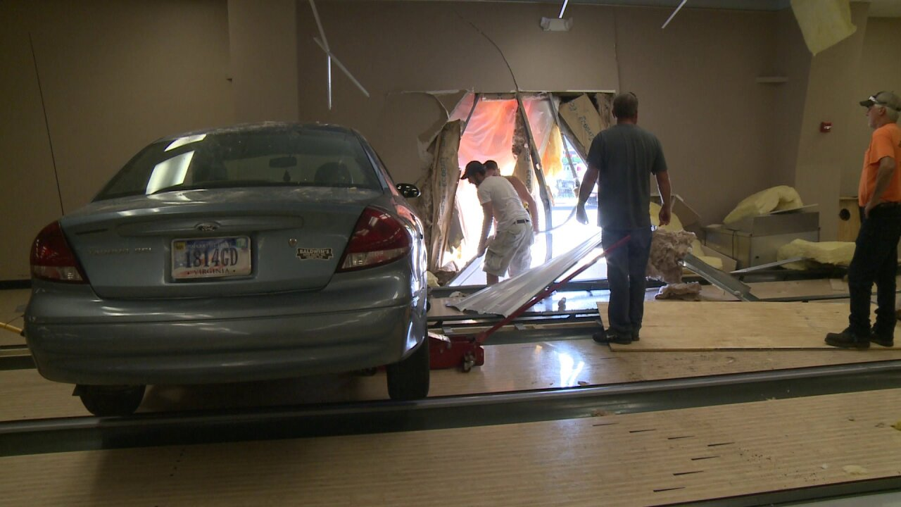Car removed after being crashed into Nottoway bowling alley; womancharged