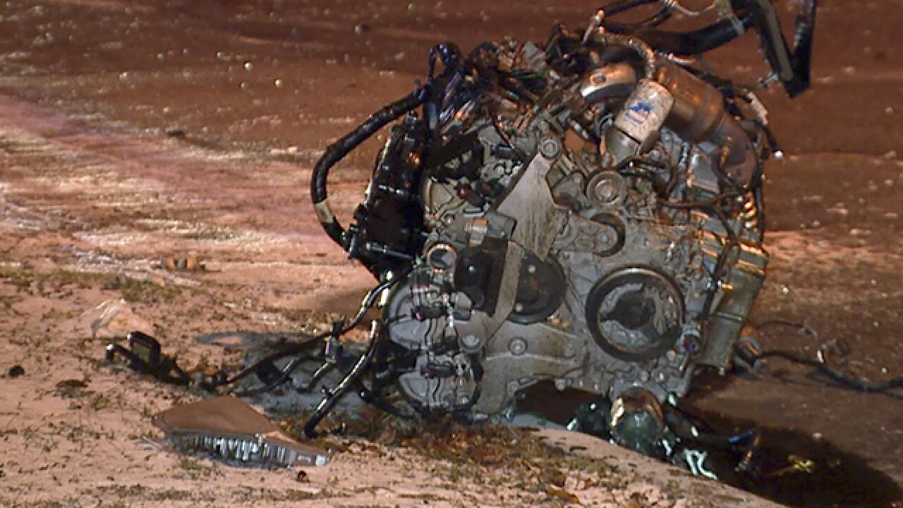 Engine torn from a car after hitting a tree