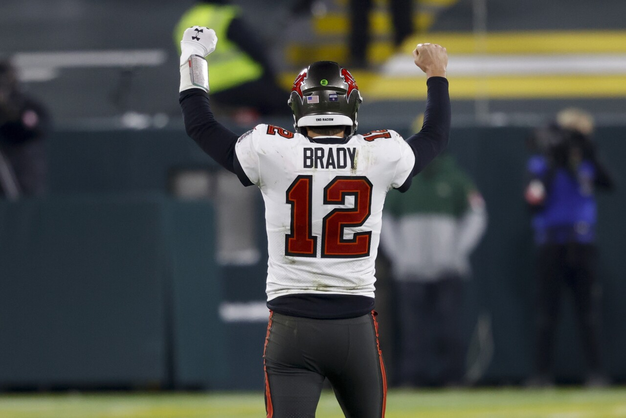 Tampa Bay Buccaneers QB Tom Brady holds hands in air after beating Green Bay Packers to win NFC Championship, Jan. 24, 2021