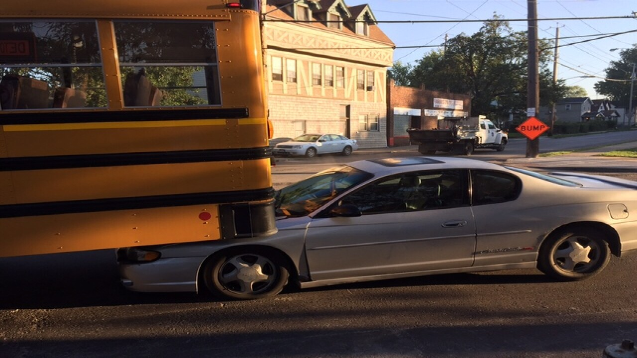 PHOTO: Car wedged under school bus after crash