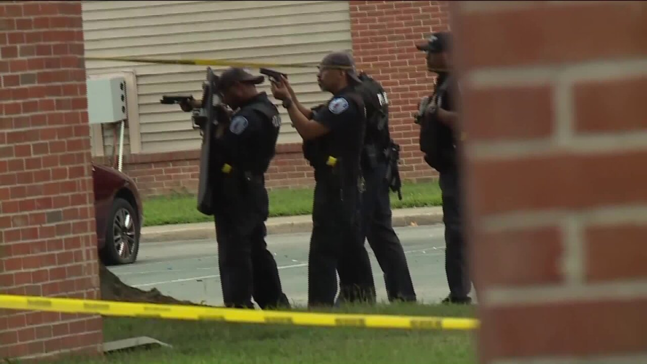 Man barricaded after parking lot gun battle at Richmond apartments, Crime Insidersays
