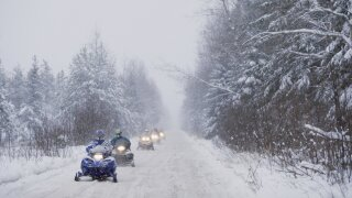 New York courts snowmobiling tourists with free weekend