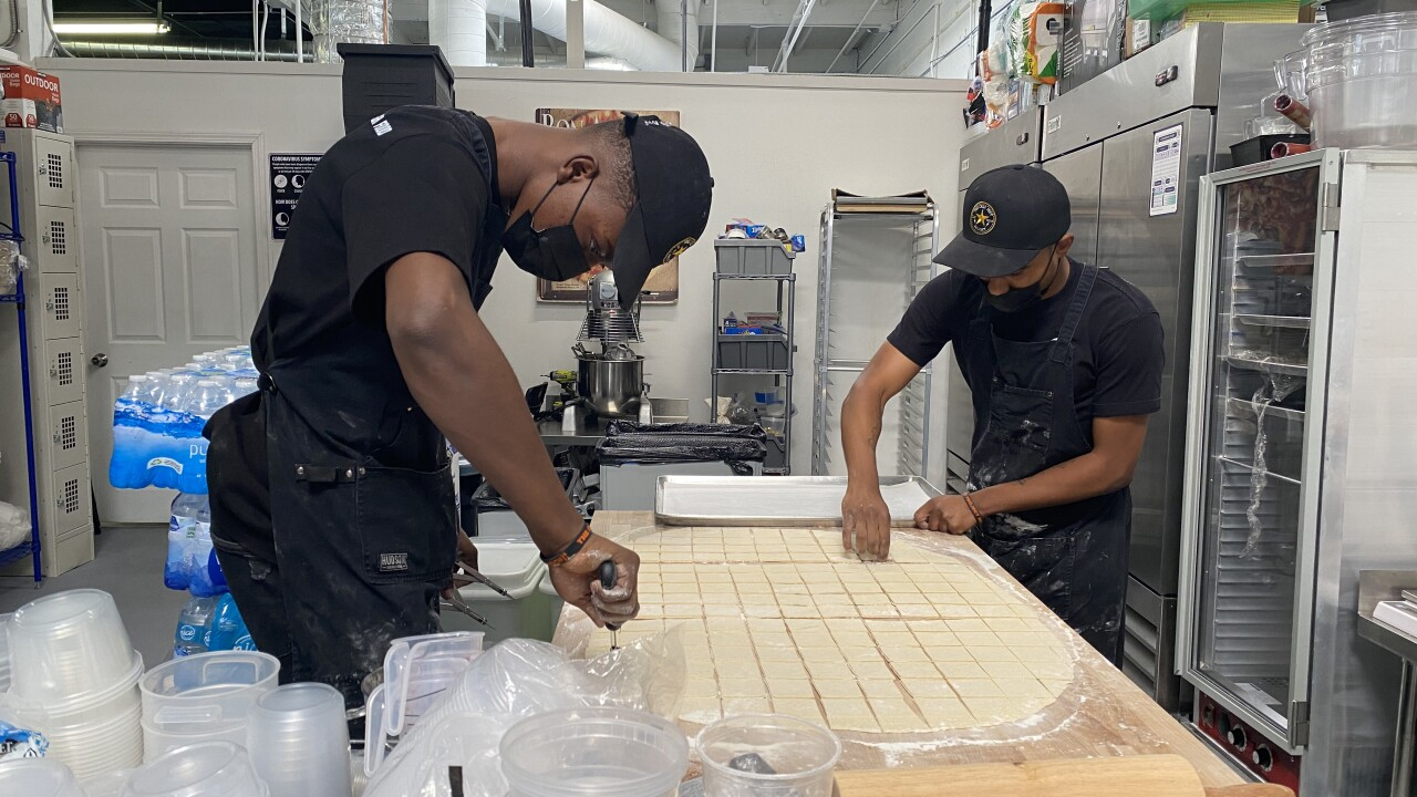 Young adults in the Chef Jeff Project make beignets from scratch