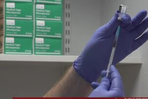 As COVID-19 cases surge in the U.S., many companies weigh vaccine mandates