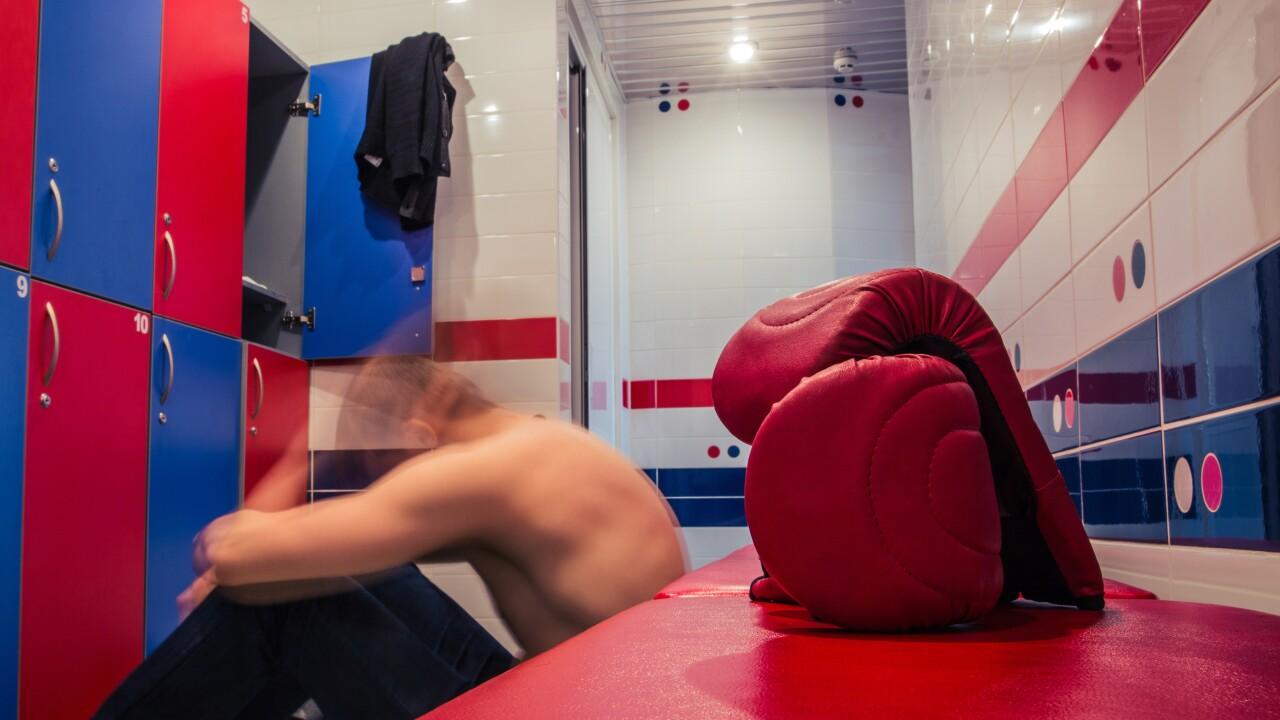 Man resting in locker room after training