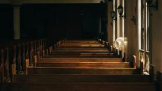 brown-wooden-church-bench-near-white-painted-wall-133699.jpg