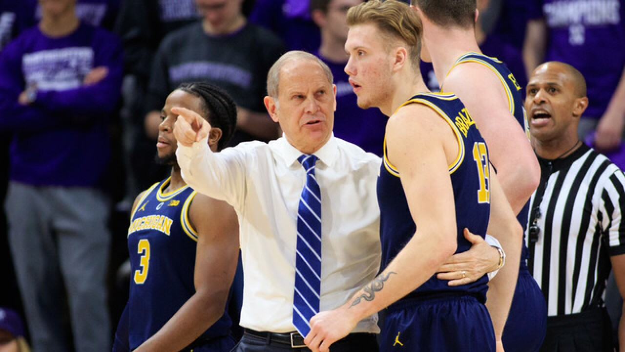 No. 5 Michigan holds off Northwestern