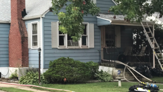 Man taken to hospital after being pulled him from a house fire Wednesday