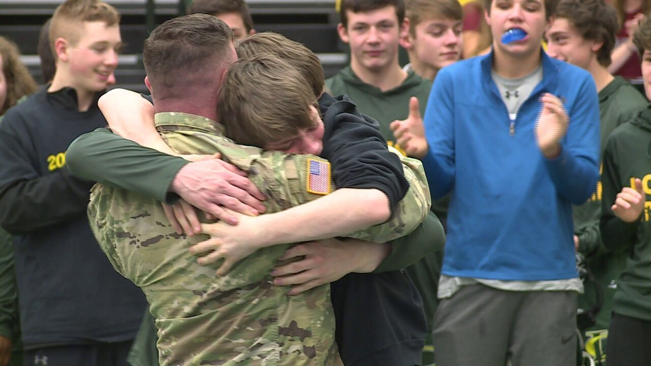 Military dad surprises brothers at wrestling match: 'I was in disbelief'