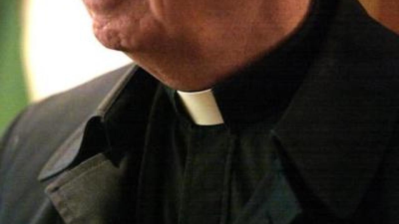 Priest wearing collar with black jacket, black shirt