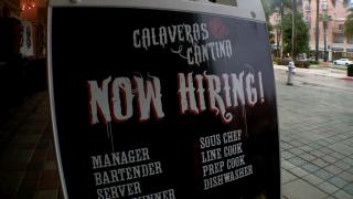 'Calaveras Cantina Now Hiring!' sign