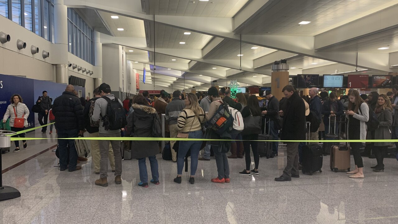 Winter weather leaves thousands of travelers in limbo after Thanksgiving weekend