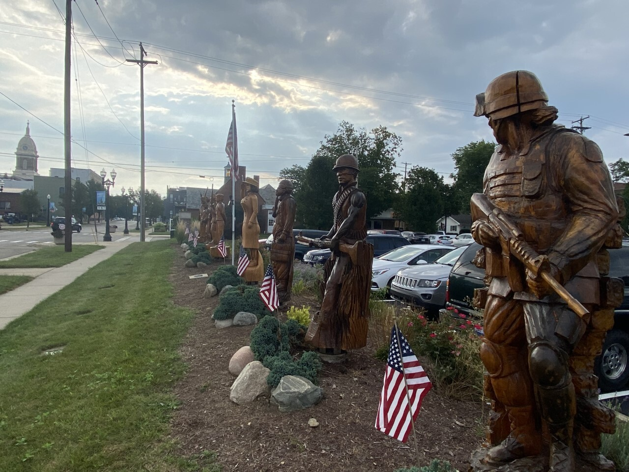 Eight soldiers representing eight U.S. wars outside of Mason City Hall
