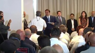 Florida Gov. Ron DeSantis hands out $1,000 bonus checks to first responders in Surfside on Aug. 10, 2021.jpg