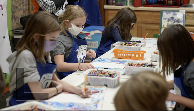 Children drawing during a class at Jackson school of the arts