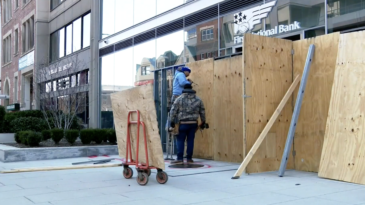 Amid concerns about more potential violence, buildings around Washington, D.C. that were not boarded up before, are in the process of doing so, ahead of the presidential inauguration.