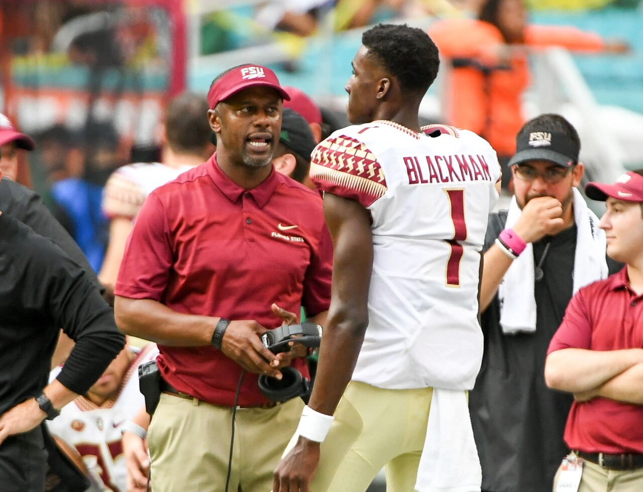 Florida State Seminoles head coach Willie Taggart speaks to QB James Blackman on sideline vs. Miami Hurricanes in 2018