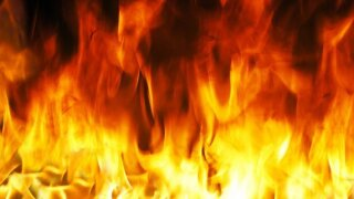 FD: Woman calls 911 from inside burning home, survives
