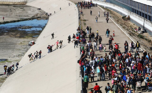 PHOTOS: Migrants rush US/Mexico border to demand asylum