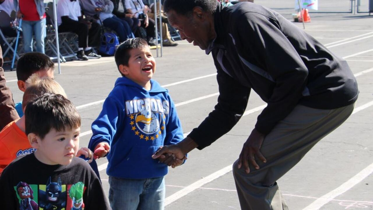 Rafer Johnson shaking hands with students.JPG