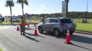 SUV arrives for coronavirus testing site at FITTEAM Ballpark of the Palm Beaches