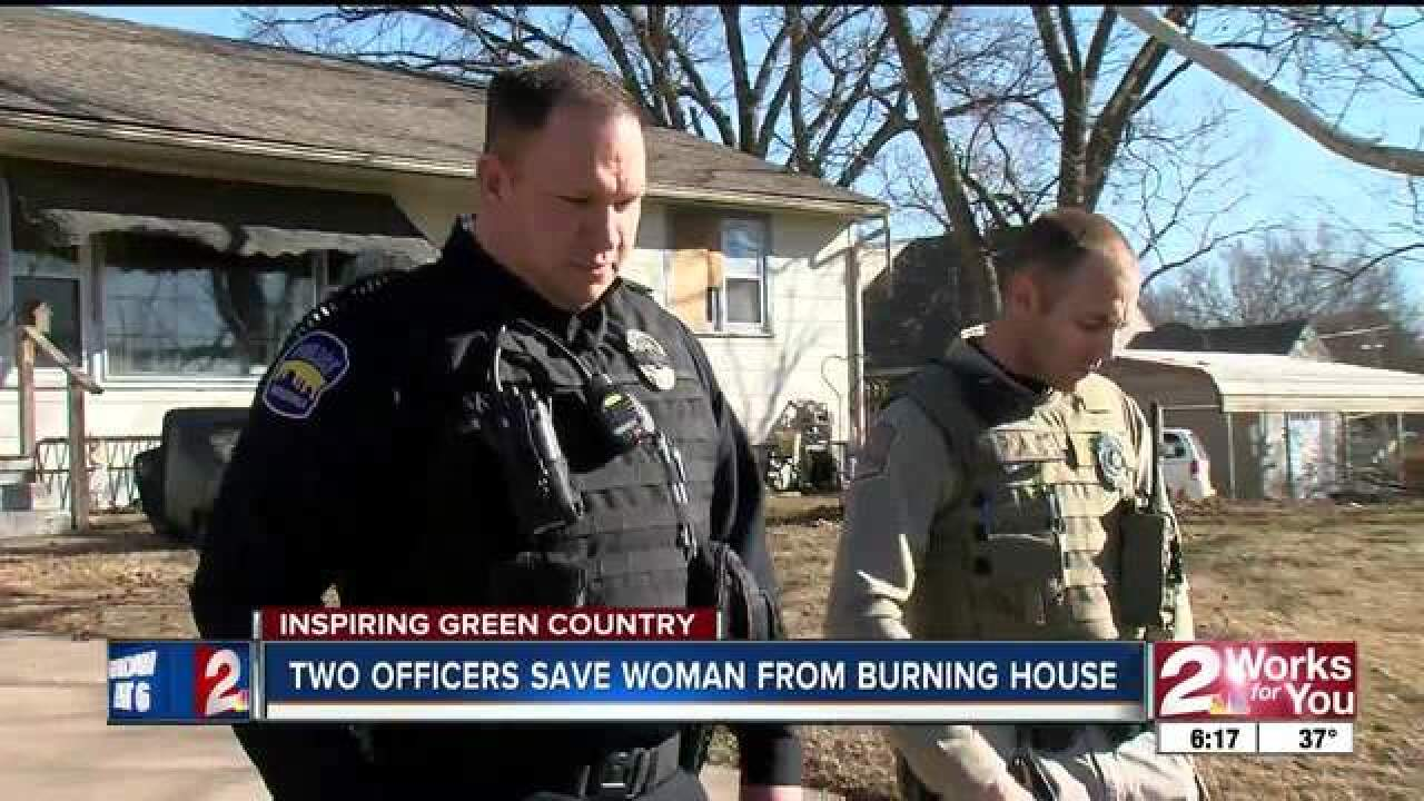 Two officers save woman from burning house