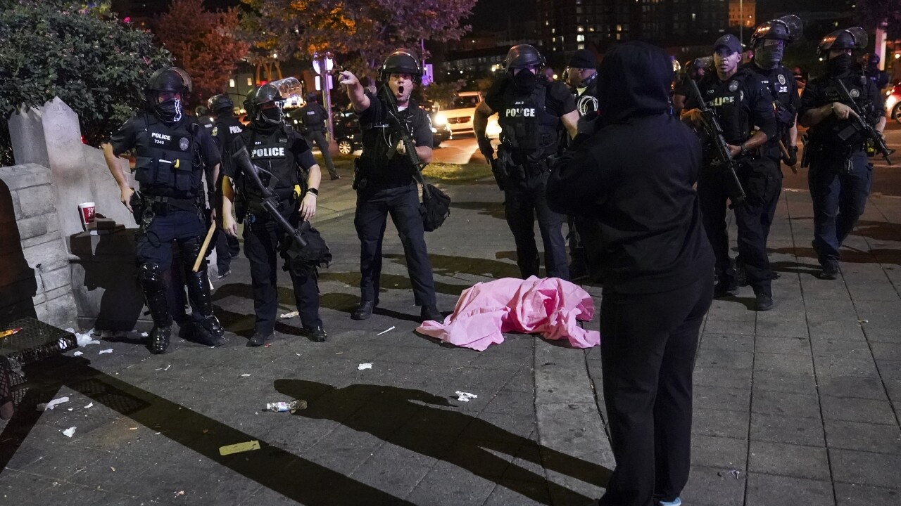 Dozens taken into custody during Louisville protests; 2 wounded officers expected to survive