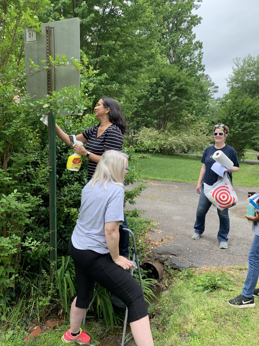 Photos: Volunteers 'couldn't wait' to clean up White Power, swastika graffiti in West Endneighborhoods