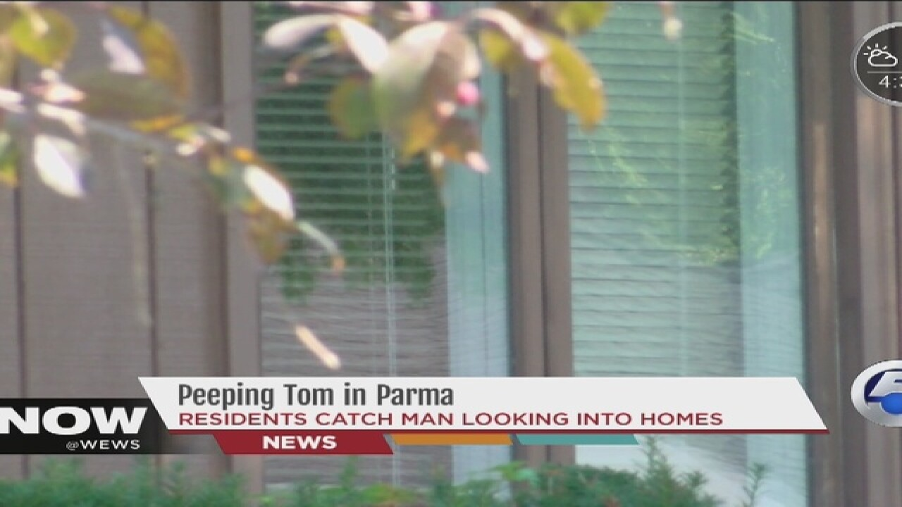 Resident reports man peeping in window