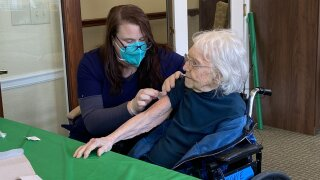 107 year old receives COVID vaccine