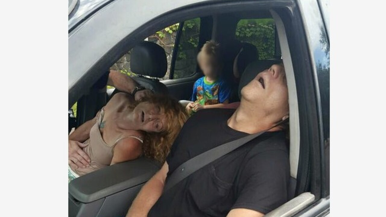 Photo shows couple passed out from overdose with 4-year-old child in backseat