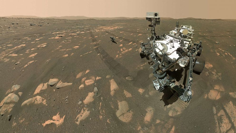 NASA's Perseverance Mars rover took a selfie with the Ingenuity helicopter, seen here about 13 feet from the rover in this image taken April 6, 2021, by the WATSON (Wide Angle Topographic Sensor for Operations and eNgineering) camera, located at the end of the rover's long robotic arm.