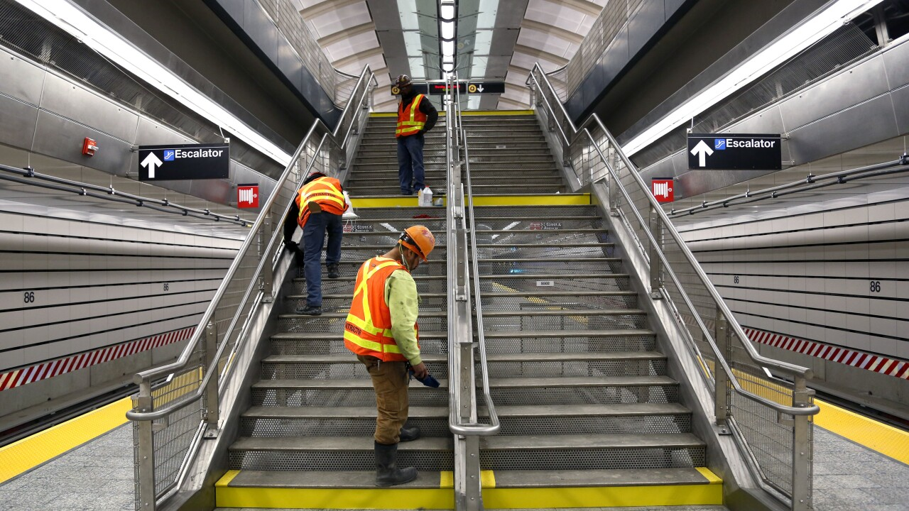 Workers clean in subway station