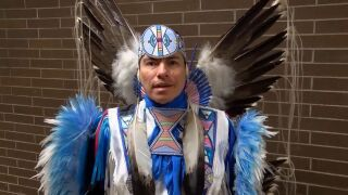 """Supaman"" (Christian Parrish Takes The Gun) is a member of the Crow tribe who performs fancy dance, hip-hop, rap, and comedy"