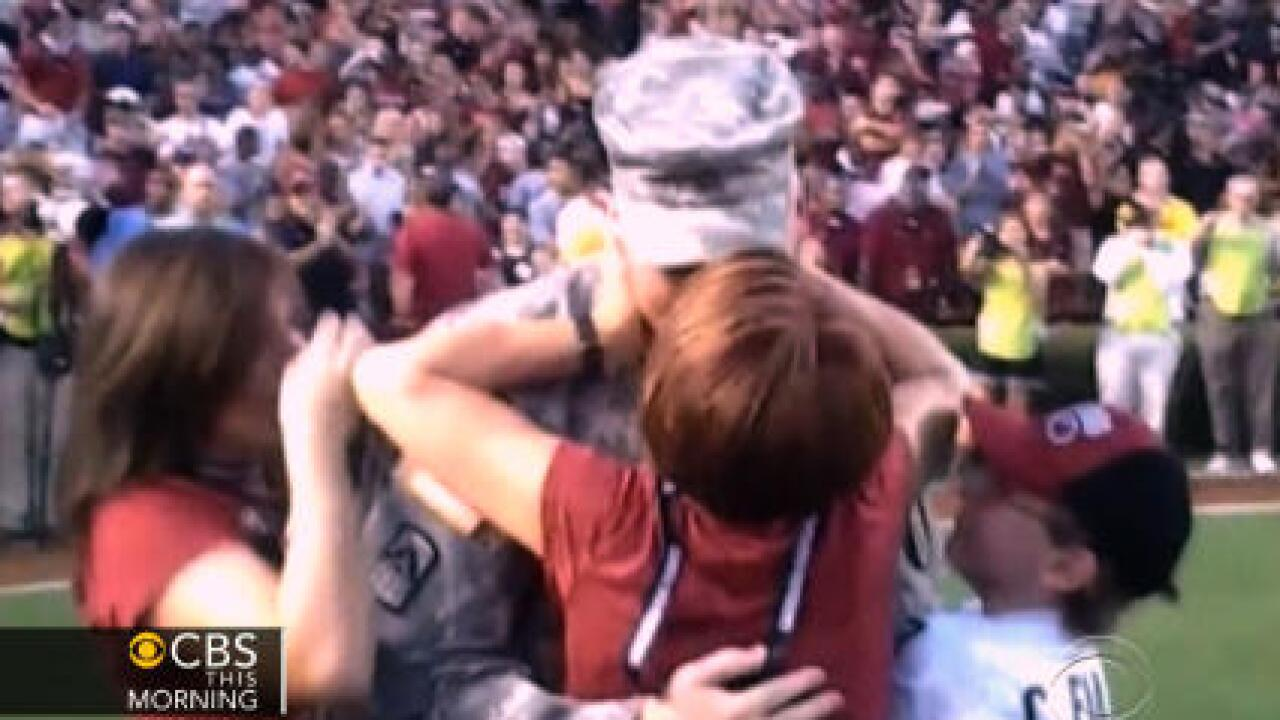 Military family reunion surprise at football game