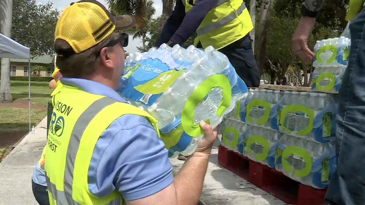 Crews distribute cases of water at Gaines Park in West Palm Beach on May 31, 2021.jpg