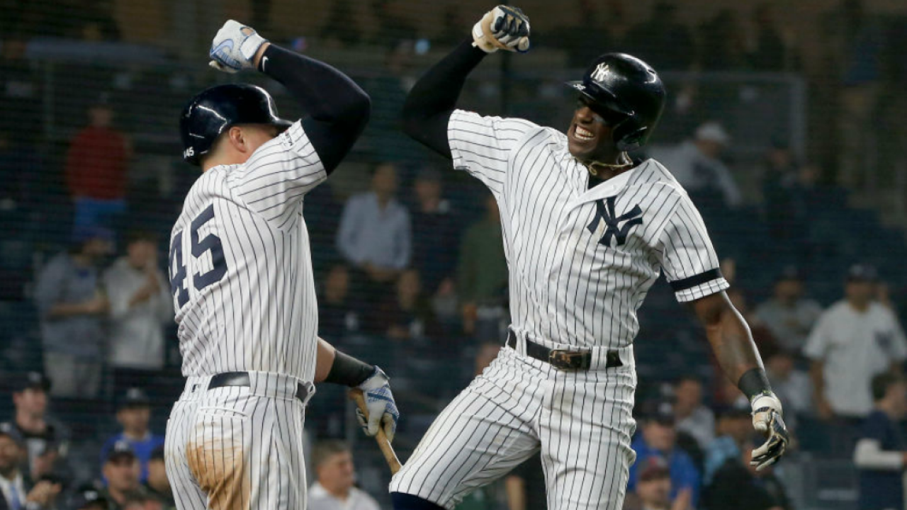 Cameron Maybin celebrates home run with Luke Voit