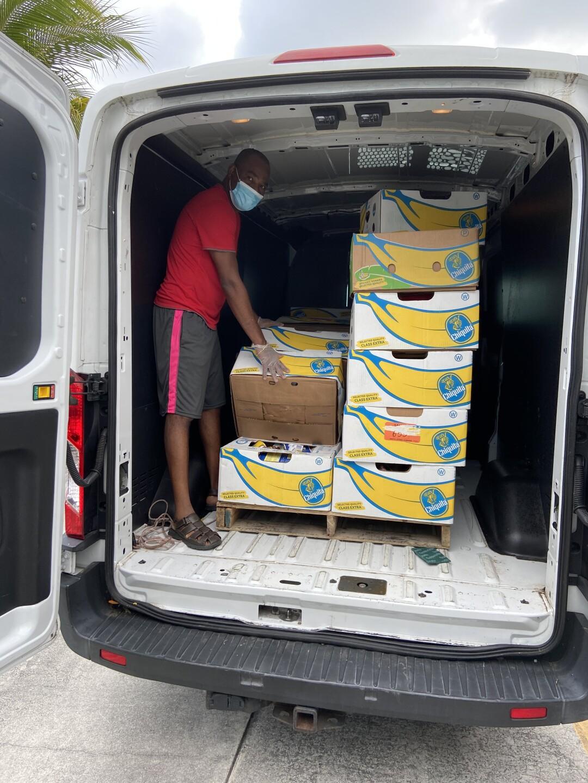 Haitians receive boxes of Chiquita bananas