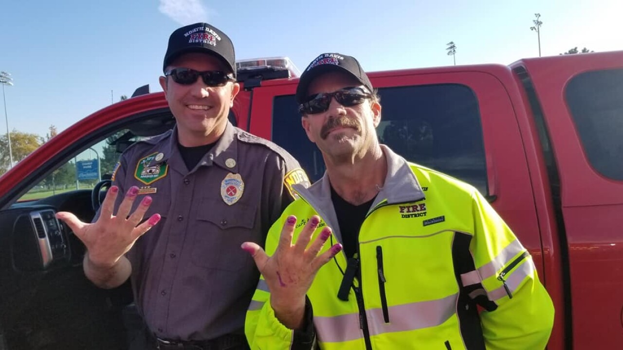 Firefighters calm little girl in car crash by letting her paint their nails