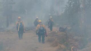 Mullen Fire_firefighters walking in smoke