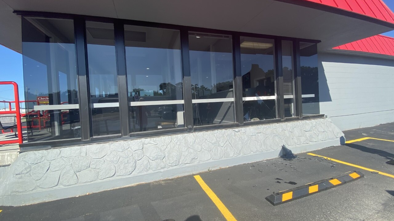 Windows smashed at AutoWest, 487 28t