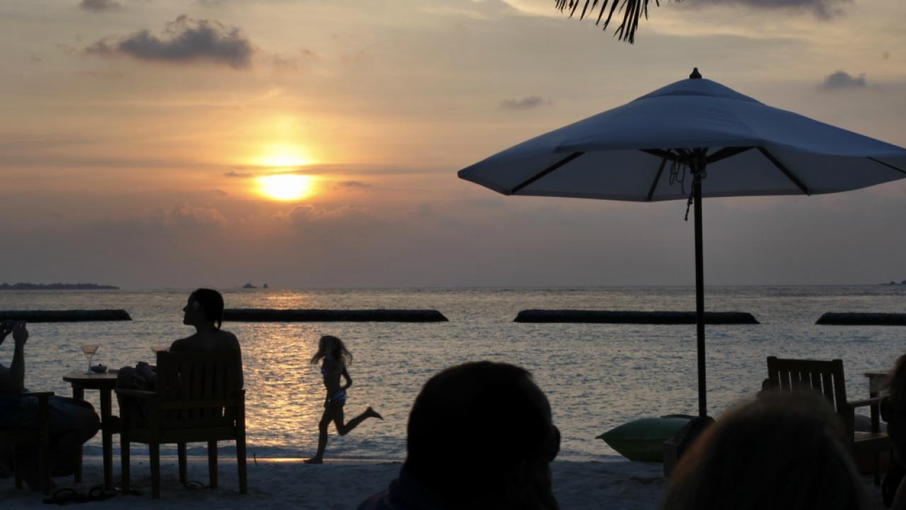 Maldives tourist sunset